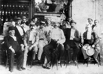 "A group of men enjoying ""Brad's Drink"" in Bradham's Pharmacy in 1896. Image from the North Carolina Museum of History."