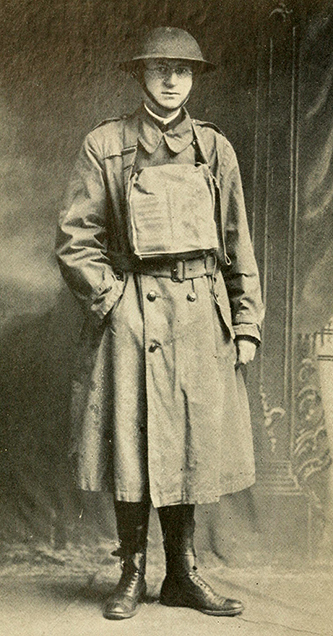 "A photograph published in 1919 of Elmer Talmage Clark in World War I ""trench equipment."" Image from the Internet Archive."