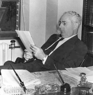 A 1952 photograph of David Leroy Corbitt in his office. Image from the North Carolina Musuem of History.