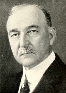 Photograph of J. Elwood Cox, circa 1931. Image from Archive.org.