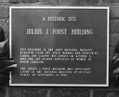 A photograph of the plaque on the Julius I. Foust building on the UNC-G campus. Formerly called the Administration Building it was renamed for Foust in 1960, and put on the National Register of Historic Places in 1980.