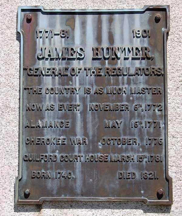 Photograph of plaque dedicated to James Hunter on the Hunter Monument at the Alamance County Battleground, Burlington, NC. Item #S.HS.2008.45.1, from North Carolina Historic Sites, North Carolina Department of Cultural Resources.  The Hunter Monument was originally located at Guilford Battle Ground in Greensboro, NC and subsquenetly relocated to the Alamance County battlefield, site of the Regulator defeat in 1771.