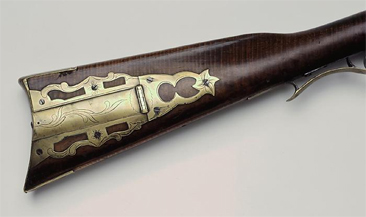 Image of rifle stock with ornate brass patch box, made by David Kennedy, circa 1820-1850, made at Mechanics Hill.  Item H.1945.81.20 from the collections of the North Carolina Museum of History. Used courtesy of the North Carolina Department of Cultural Resources.