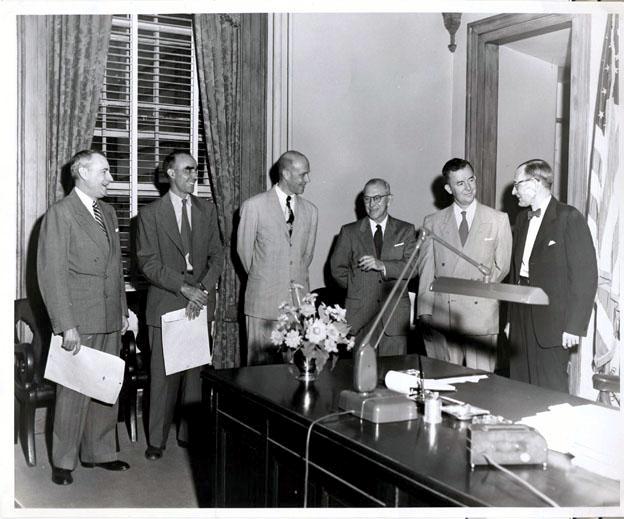 A photograph, circa 1953-1954 of (left to right): Paul A. Reid, Hugh T. Lefler, Christopher C. Crittenden, William T. Polk , James A. Stenhouse, and William B. Umstead. Image from the North Carolina Museum of History.