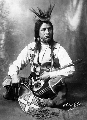 A studio portrait of Buffalo Child Long Lance taken in Regina, Saskatchewan, circa 1908. Image from Atlanta Journal-Constitution Photographic Archives at Georgia State University Library.