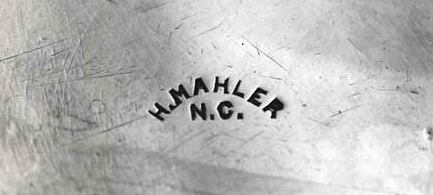 Henry Mahler's hallmark, or maker's mark, stamped on the bottom of a beaker made by him. Image from the North Carolina Museum of History.