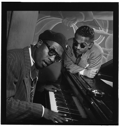 Portrait of Thelonious Monk and Howard McGhee, Minton's Playhouse, New York, N.Y., ca. Sept. 1947, by William P Gottlieb. Item LC-GLB23-0625 DLC from the William P. Gottlieb Collection, Library of Congress. The image was dedicated to the public domain by William P. Gottlieb.