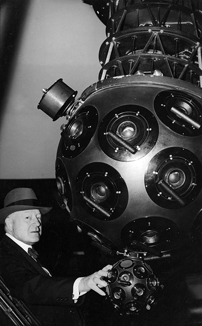 A photograph of John Motley Morehead, III in the Morehead Planetarium at UNC-CH. In 1946 he donated one million dollars for its construction, which was completed in 1949. Image from the North Carolina Collection Photographic Archives, University of North Carolina at Chapel Hill.