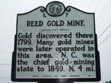 Reed Gold Mine's marker on SR 1100 (Reed Mine Road) west of Cabarrus/Stanly County line in Cabarrus county. Photo is presented on North Carolina Highway Historical Marker Program.