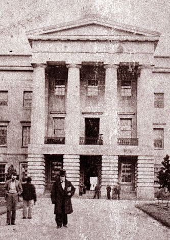 A photograph of David Settle Reid (in top hat) in front of the capitol building in Raleigh, circa 1861. Image from the State Archives of North Carolina.
