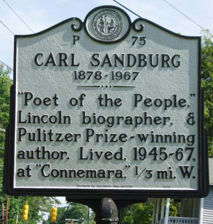 Carl August Sandburg's marker is located on Little River Road in Flat Rock in Henderson County.  Photo is courtsey from the North Carolina Highway Historical Marker Program.