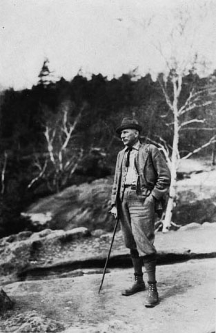 """The Doctor Himself, Spring 1926."" Kallitype photograph of Carl Alwin Schenck posing on a rocky outcrop; taken by ""ah,"" taken 1920s. Item MC00035, Special Collections Digital Resources, Special Collections Research Center, North Carolina State University Libraries.  Used by permission."