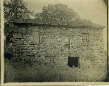 "Photograph of Adam Spach's ""Rock House"" in Forsyth County, built by Adam Spach circa 1774, image taken circa 1900-1920.  Item H.1946.14.223  from the collections of the North Carolina Museum of History.  William Elias Spach was a descendent of Adam Spach."