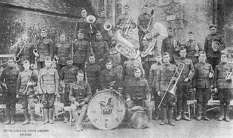 A photograph of the 105th Engineers, 30th Division Regimental Band, Marseilles, France, January 7, 1919. Lamar Stringfield is in the first row at the extreme left.  Image courtesy of the Audio Visual Materials Unit, State Archives of North Carolina.