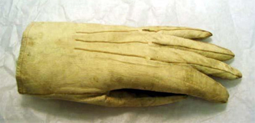 Photograph of the glove, a military uniform accessory circa 1860-65, of James I. Waddell, worn in the United Kingdom and France. Glove held in the collections of the North Carolina Museum of History.