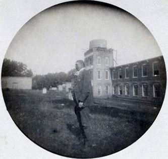 Photograph of James Nathaniel Williamson in front of the Ossipee Mills on the Haw River, Oct. 2, 1889.