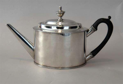 Photograph of silver teapot made by Freeman Woods, circa 1791-1810.  Item P.TP.2005.002.001, from Tryon Palace, New Bern, NC.
