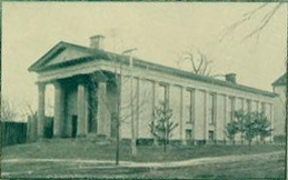 """Smith Hall, Library,"" from the University of North Carolina Yearbook <i>The Hellenian</i>, 1897.  Benjamin Wyche is considered the first professional librarian of the University of North Carolina and Smith Hall was used as the university library during his tenure as librarian.  Presented on DigitalNC."