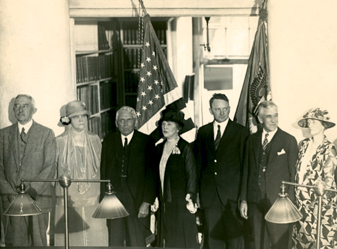"""A rare photograph with Bessie Alderman, taken at a reception in the Rotunda. Left to right: President Edwin A. Alderman, Mrs. Bessie Alderman, Secretary of State Frank B. Kellogg and Mrs. Kellogg, Governor Harry Flood Byrd, Dean Charles G. Maphis, and Mrs. Maphis. Photo by Frank Mitchell."" Courtesy of UVA Special Collections."