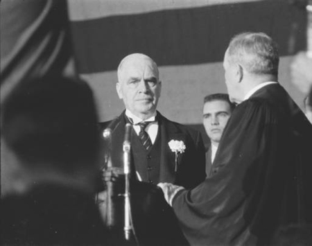 Barnhill swearing in Luther H. Hodges. Image courtesy of the Hugh Morton Collection at UNC Libraries.
