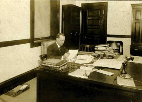 Willis Grandy Briggs seated at desk, 1913-1914. Image courtesy of the NC Museum of History.
