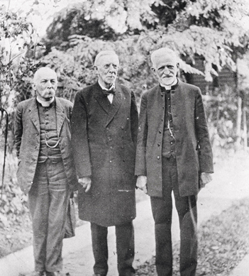 """This portrait is titled, ""Moravian Bishops."" Bishop Edward Rondthaler (1842-1931) is at the center. The other two men are not identified. Bishop Edward Rondthaler took over the pastorate of the Salem Moravian congregation in 1877. He was named a bishop in 1891."" Courtesy of Digital Forsyth."
