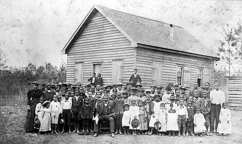 Professor Jacob's School, African-American, students and teacher in front of school, early 1900's, Lake Waccamaw, NC, Columbus County. From the General Negative Collection, North Carolina State Archives, call #:  N_89_1_71, Raleigh, NC.