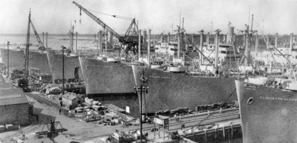 Ships lined up at outfitting piers of the North Carolina Shipbuilding Company in Wilmington. North Carolina Collection, University of North Carolina at Chapel Hill Library.