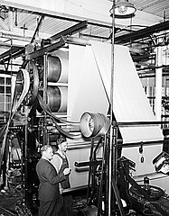 Combed Yarn Industry, NC, 1938. Cloth going through calendar rolls into finishing machine. Image courtesy of State Archiveso of North Carolina, call #: ConDev1821A.
