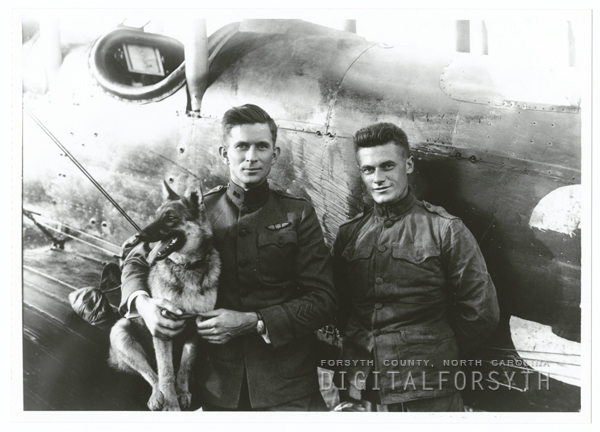 Maynard Belvin with his dog, Trixie, and mechanic, William Kline