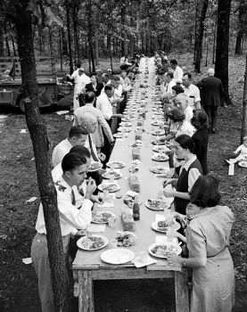 Enjoying a meal of pit-cooked barbeque with friends and family, Braswell Plantation near Rocky Mount, NC, September 1944. From Conservation and Development Department, Travel and Tourism Photo Files, North Carolina State Archives, call #:  ConDev4648B, Raleigh, NC.