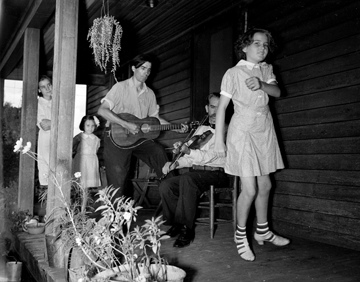 Asheville Mountain Music Festival Asheville August 1938, photo taken by Baker. The musicians are Osey and Ernest Helton. Conservation and Development Department, Travel and Tourism Division Photo Files, North Carolina State Archives, call #:  ConDev1424C.