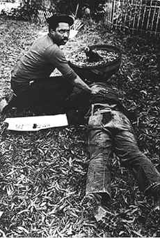 """Nelson Johnson at the body of Dr. James Waller, November 3, 1979, Greensboro, NC. """