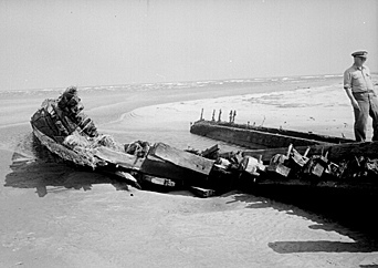 Unknown wreck fround in 1944, Ocracoke or Hatteras. NC, photo taken by Brown. From Conservation and Development Department, Travel and Tourism photo files, North Carolina State Archives, Raleigh, NC, call #: ConDev4876C.