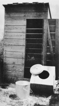 Sampson County privy (showing a new seat before it was installed), ca. 1915. Courtesy of North Carolina Office of Archives and History, Raleigh.