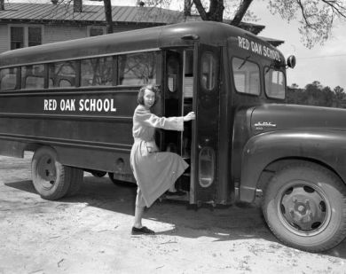 Woman stepping onto Red Oak Farm-Life High School Bus, Nash County, 1952. Image courtesy of the Braswell Library.