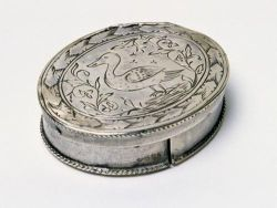 """This engraved patchbox, ca. 1720, was used to hold small pieces of fabric that women used as fashion accessories. The maker is unknown."" Image available from the NC Museum of History."
