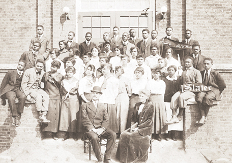 Slater Industrial Academy 1915 student body and Dr. and Mrs. Simon Green Atkins. Dr. and Mrs. Atkins are sitting in front of the students. Image available from Digital Forsyth.