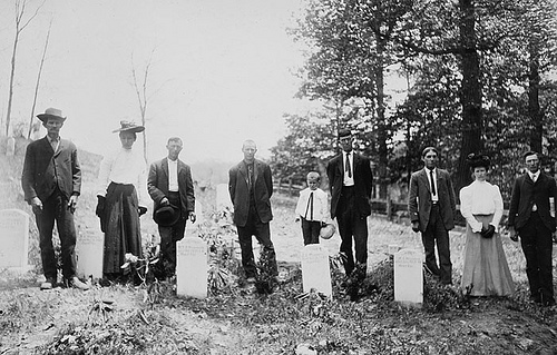 """Wiseman Family at graves of brothers and sisters."" Frank W. Bicknell Photograph Collection, PhC.8, North Carolina State Archives, Raleigh, NC. call #: PhC8_179."