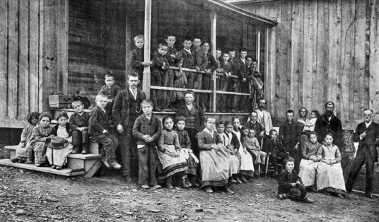 Waldensian schoolchildren and teacher (standing beside steps) at Valdese, ca. 1905. North Carolina Collection, University of North Carolina at Chapel Hill Library.