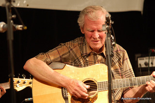"Appalachian Encounters. 2010. ""Doc Watson on stage."" Image available from Flickr user Joe Giordano."