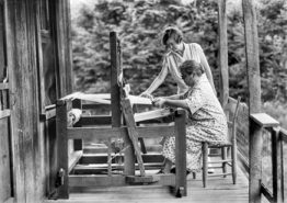 A weaver works at a loom at Penland School of Crafts, 1930. Photograph by Bayard Wootten. North Carolina Collection, University of North Carolina at Chapel Hill Library.