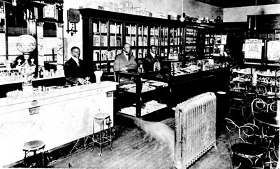 Interior, YMI Drug Store, Ahseville, NC, 1910. From the General Negative Collection, North Carolina State Archives, call #:  N_79_9_27.